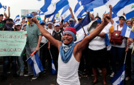 A demonstrator takes part in a protest march against Nicaraguan President Daniel Ortega's government in Managua